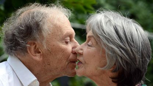 Jean-Louis Trintignant and Emmanuelle Riva exchange a kiss in Michael Haneke's Amour
