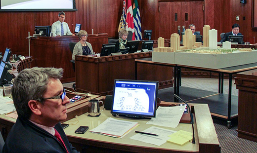 City Councillor George Affleck performing the duties of office, in the Council chambers, at City Hall