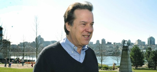 John Coupar, Vancouver Park Board Commissioner, a panoramic landscape in the background