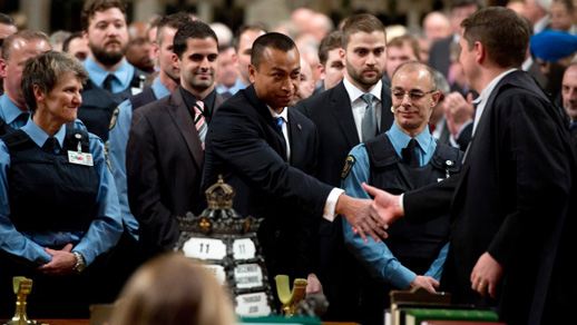 Members of Canada's Parliament honour the security detail that saved them