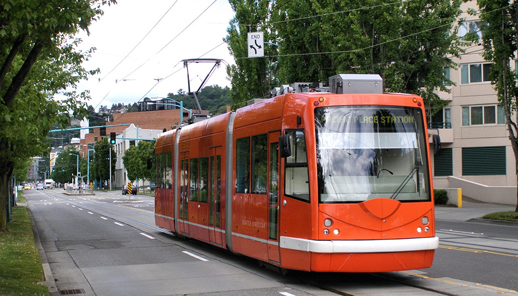Vote for low-rise, human-scale development. And, streetcars.