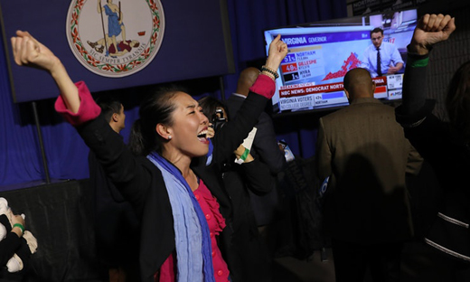 Democratic Party volunteer openingly celebrating victory on Tuesday evening