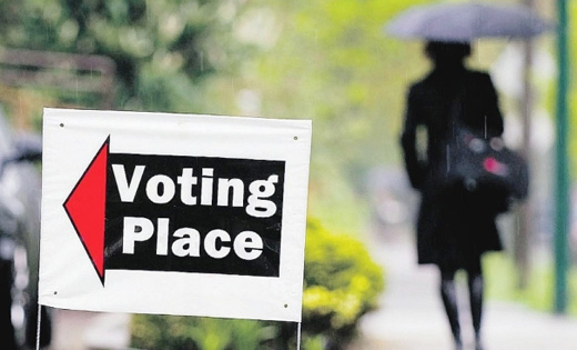 Having voted a Vancouver citizen returns home in the rain